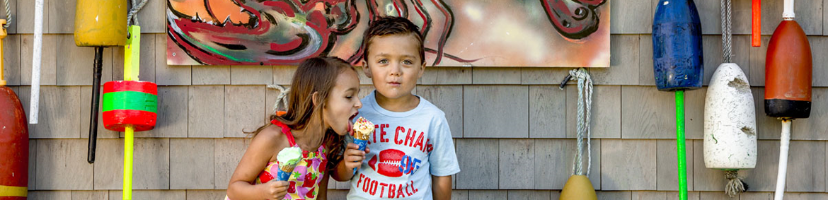two young kids eating ice cream